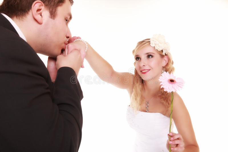 Wedding day. Male groom kissing hand of female bride. stock image