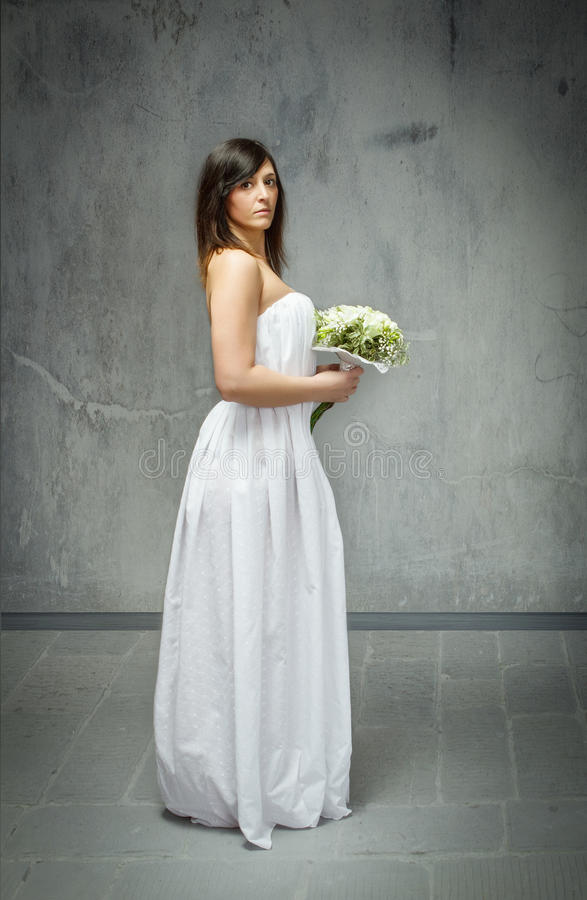 Wedding day profile view and bouquet. Person emotion in a wedding day stock image