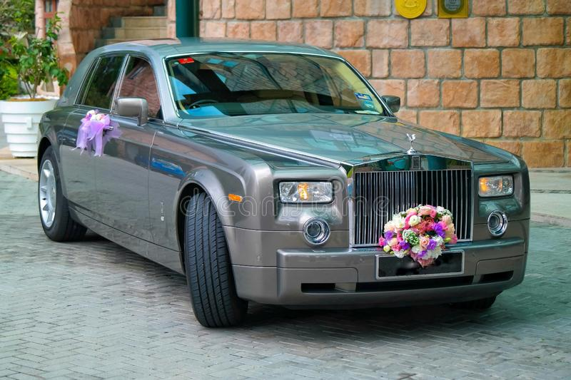 Wedding Day. Rolls rolls-royce motor motorvehicle car bouquet decorative decorated marriage style premier top luxury luxuriously transport transportation brand royalty free stock photography
