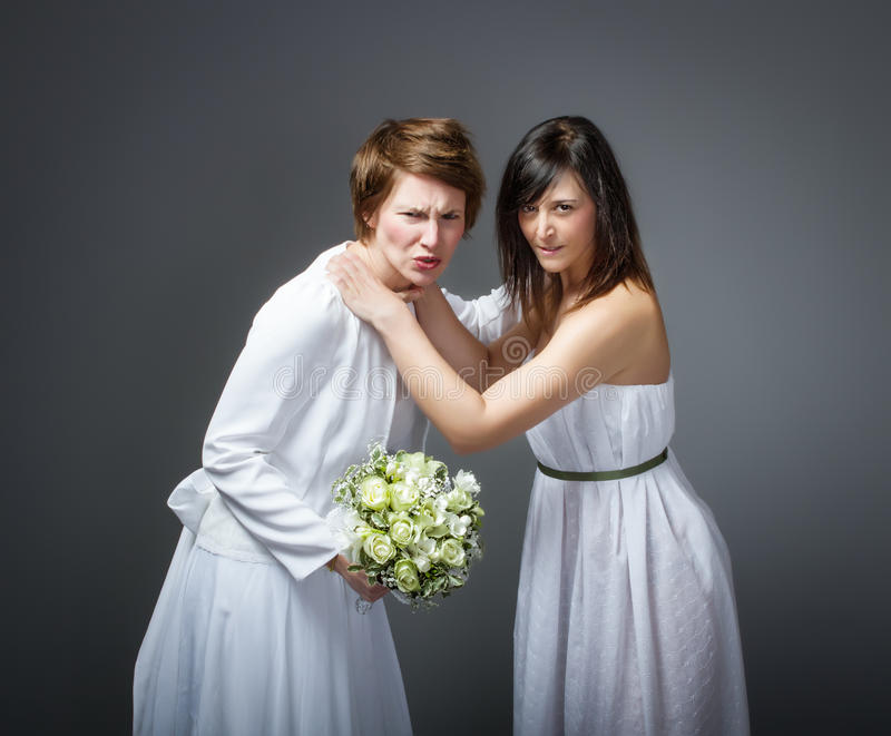 Wedding day threesome metaphor. Person emotion in a wedding day royalty free stock image