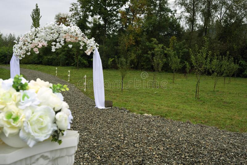 Wedding decor with arch on the outside stock image