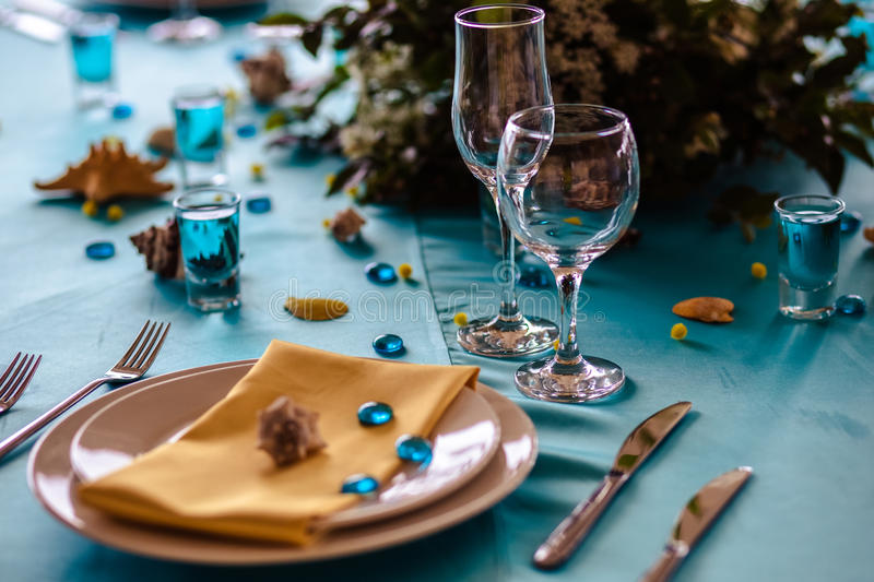 Wedding decor in blue colors, sea theme style. In a restaurant royalty free stock photo