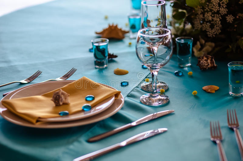 Wedding decor in blue colors, sea theme style. In a restaurant stock photography