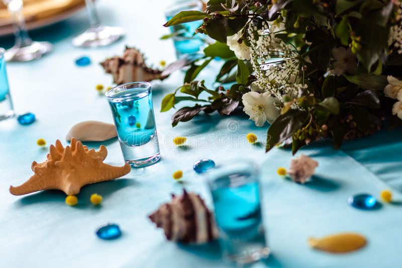 Wedding decor in blue colors, sea theme style. In a restaurant royalty free stock photography