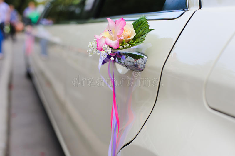 Wedding decor on the car handle stock photography