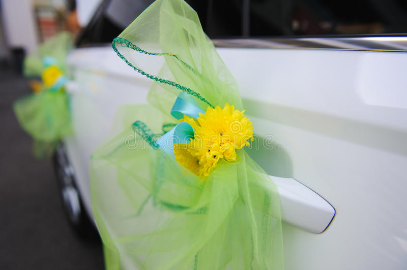 Wedding decor on the car handle stock image image of marriage wedding decor on the car handle yellow flower decoration with blue ribbons on a white limousine mightylinksfo