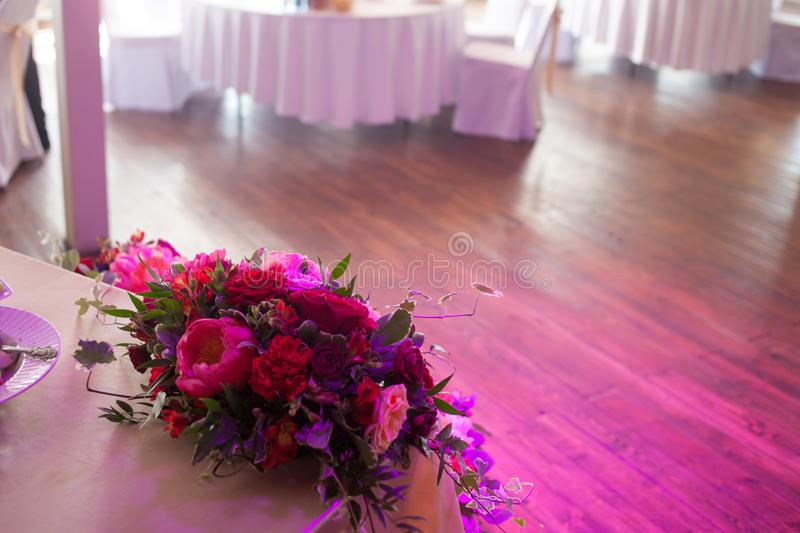 Wedding decor. Red Flowers in the restaurant, table setting stock images