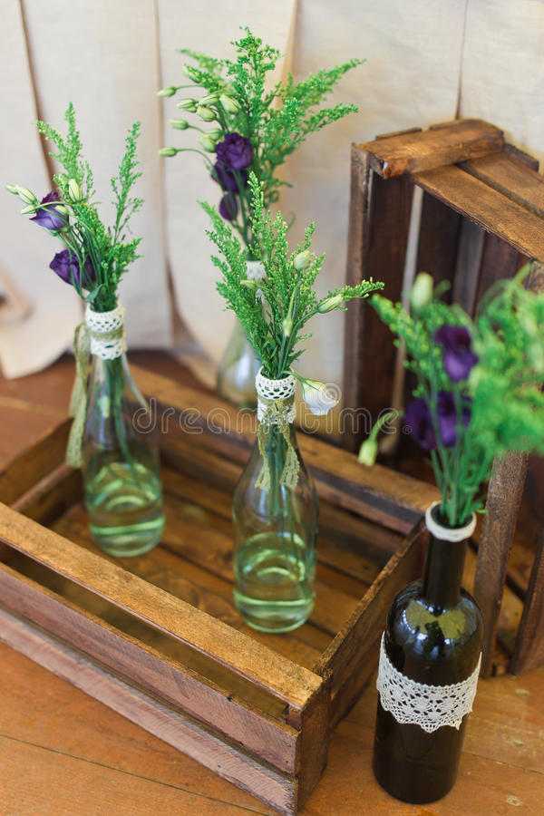 Wedding decor. Vase with bouquet of flowers stock photo