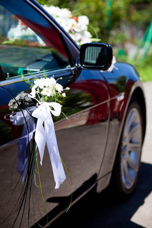 Wedding decoration. Closeup on the black car stock photos