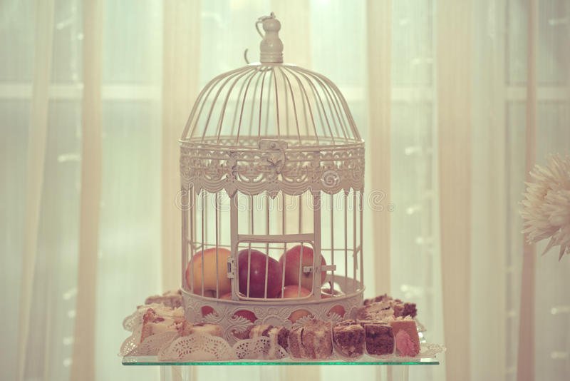 Wedding decoration with apples inside the birdcage stock photo download wedding decoration with apples inside the birdcage stock photo image of cakes metal junglespirit Image collections