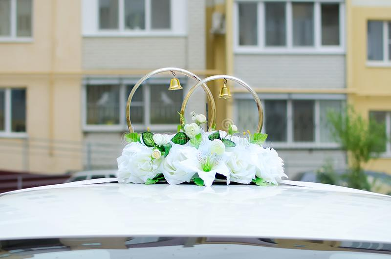 Wedding decoration for the car - rings and artificial flowers royalty free stock images