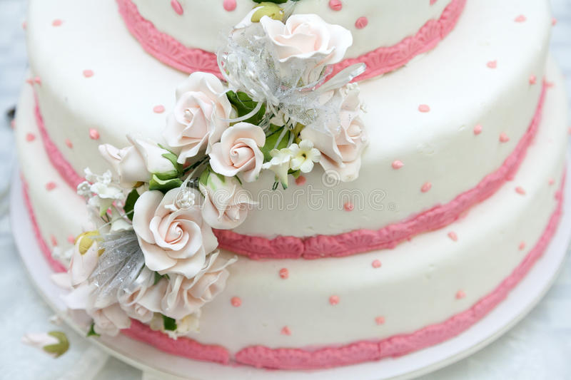 Wedding decoration. Pink and white wedding cake with roses stock photography
