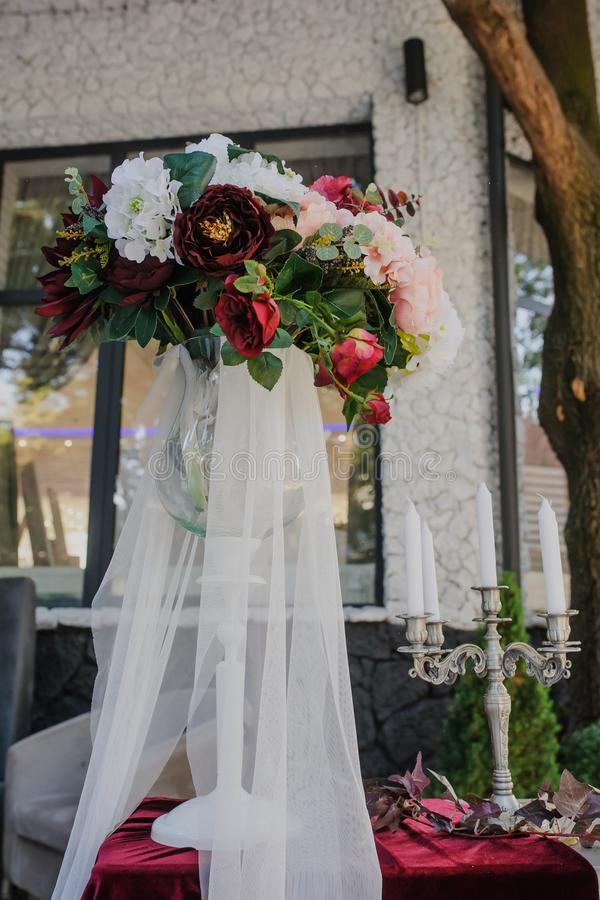 Wedding decoration. White vintage style with red / claret flower royalty free stock photography