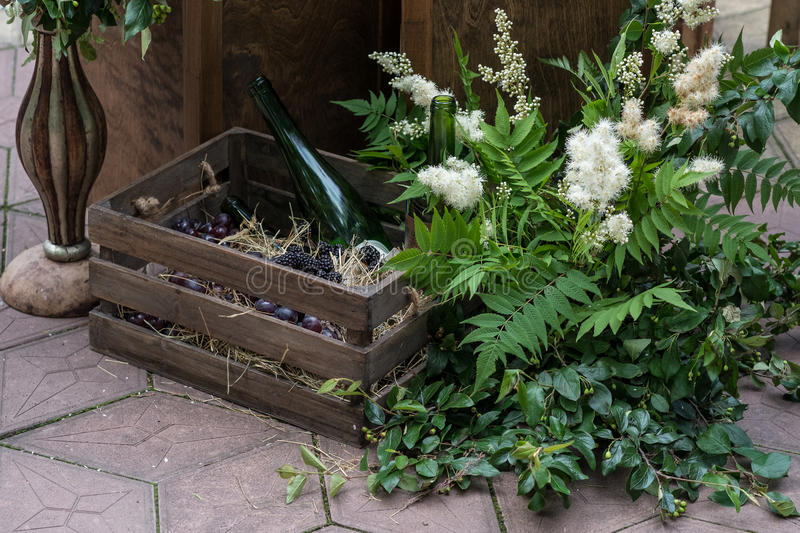 Wedding decorations with flowers wooden box and wine bottles download wedding decorations with flowers wooden box and wine bottles rustic style stock junglespirit Image collections