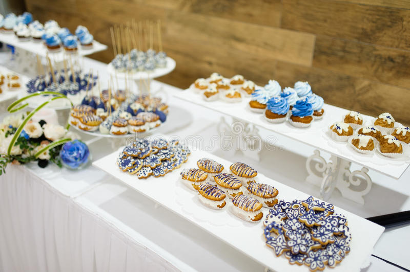 Wedding dessert table. Wedding dessert with delicious cakes and macaroons royalty free stock photography
