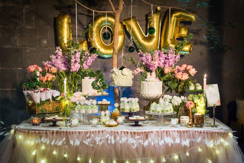 Wedding dessert. Tiered wedding cakes at indoor wedding party stock image