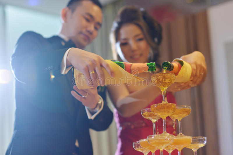 Wedding dinner champagne toasting. Asian Chinese wedding dinner reception, bride and groom champagne toasting, natural candid photo royalty free stock photos