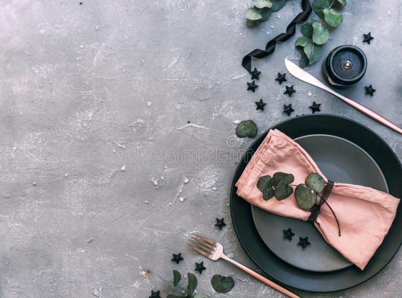 Vintage silverware on rustic shabby wooden background. Wedding dinner design. Light pastel colored tableware set: plate, vintage silverware on rustic shabby royalty free stock photos