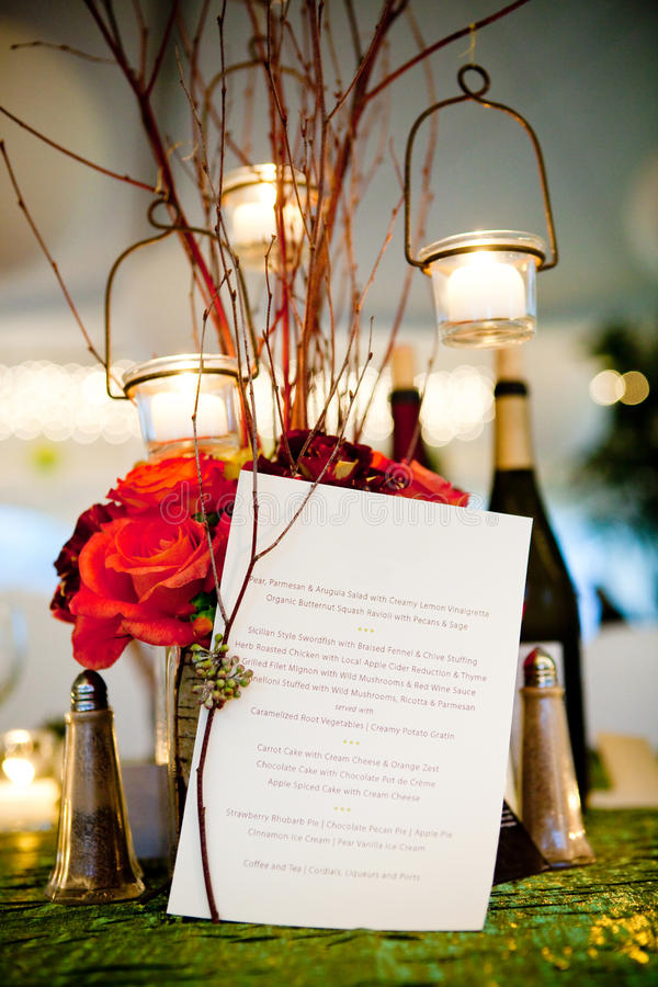 Wedding dinner menu. This is a wedding menu with a centerpiece behind it royalty free stock photos