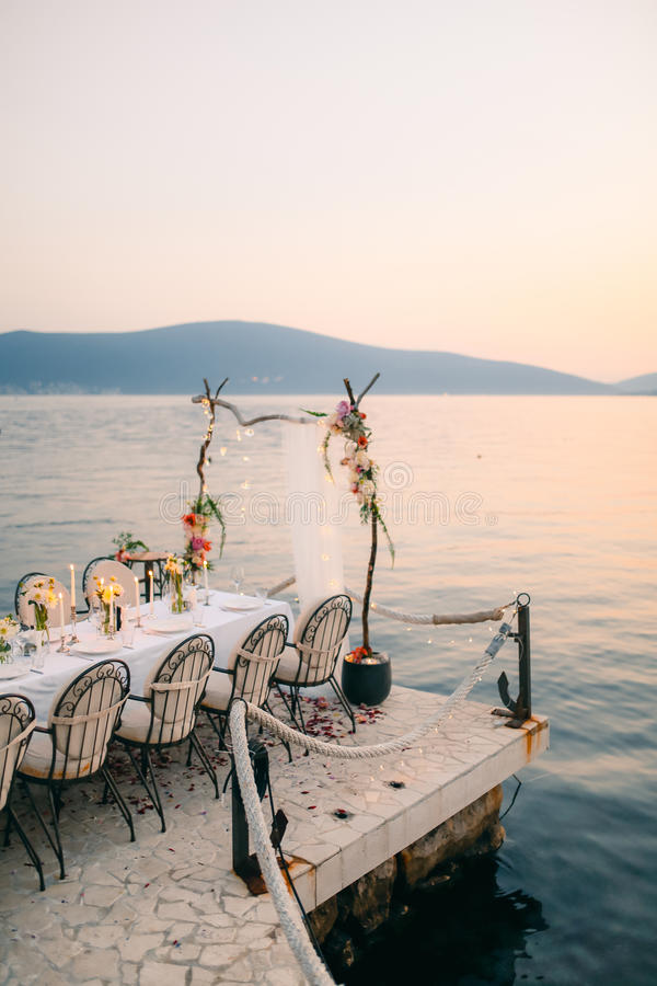 Wedding dinner by the sea. Wedding banquet at the sea. Donja Las stock images
