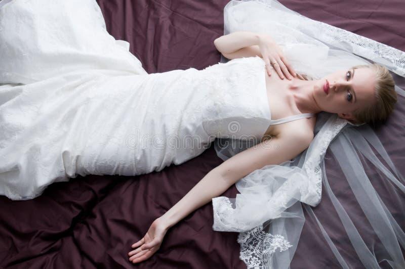 With the wedding dress. Beautiful woman wearing her wedding dress royalty free stock photo