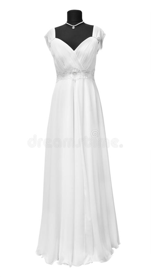 Wedding dress. On a mannequin on a white background royalty free stock photo