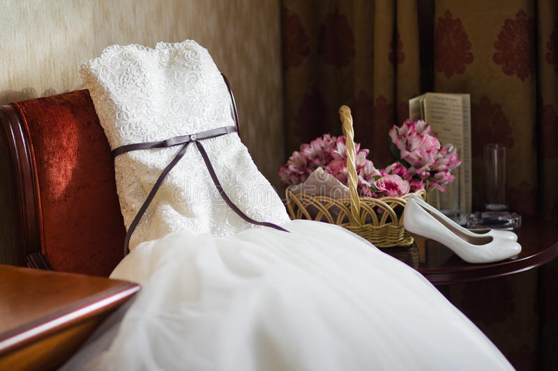 Wedding dress. Put on the chair stock photography