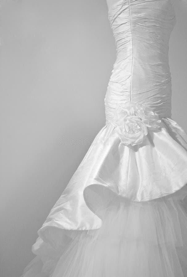 Wedding dress. Silk roses on a wedding dress stock photo