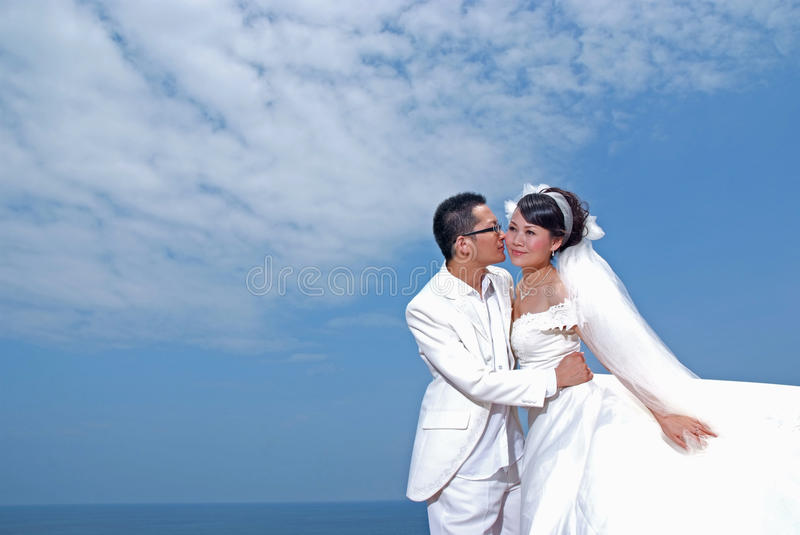 Wedding dress. A wedding dress photograph under blue sky royalty free stock image
