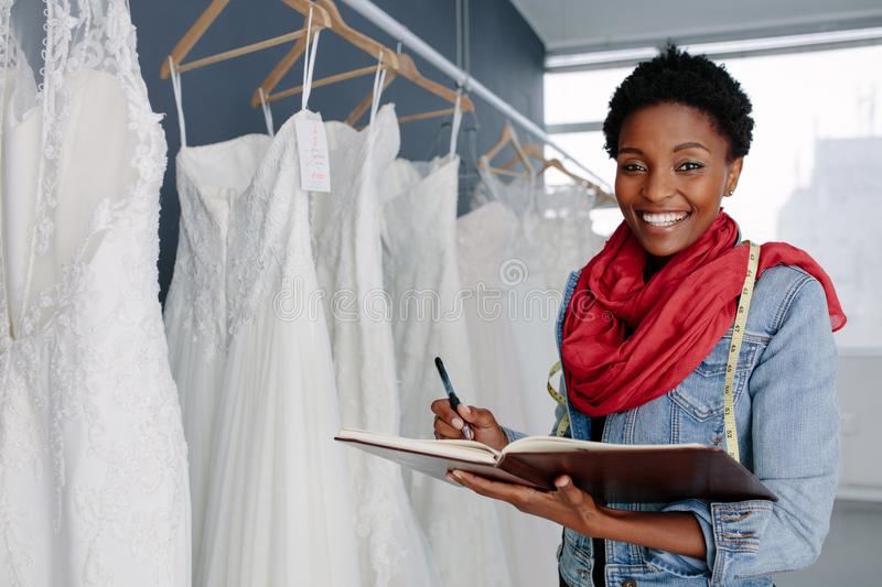 Wedding dress designer working in her boutique royalty free stock photo