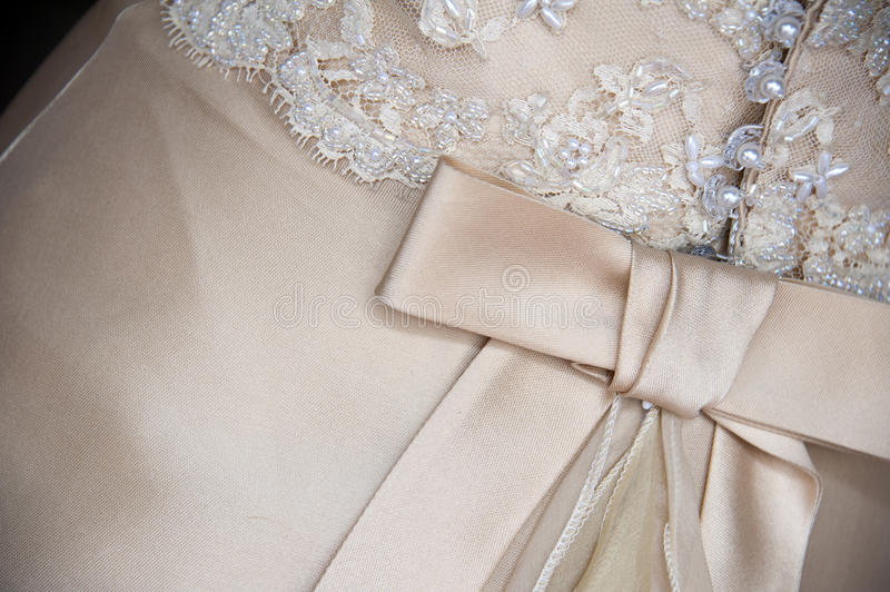 Wedding dress detail. Beautiful wedding dress detail with bow royalty free stock images