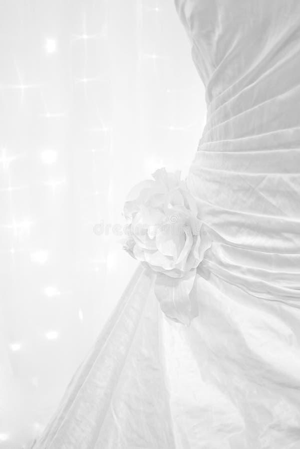 Wedding dress detail. Silk roses on a wedding dress royalty free stock photos