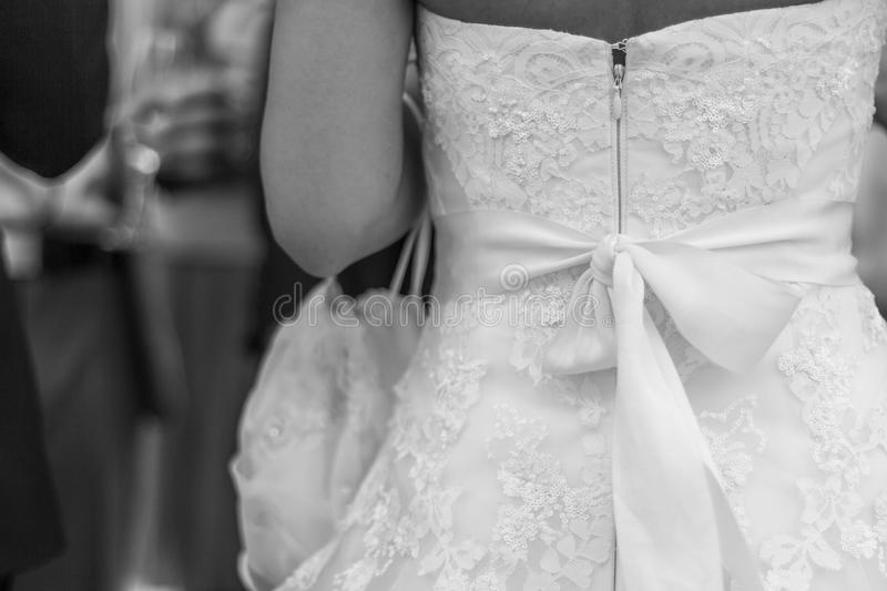 Wedding dress detail. Beautiful wedding dress detail in black and white stock images