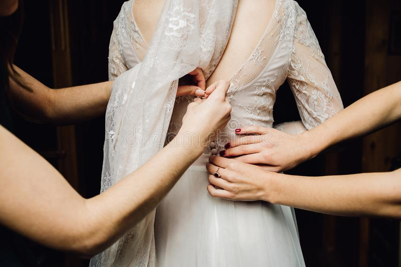 Wedding dress embroidered with crystals and pearls hangs over th stock image