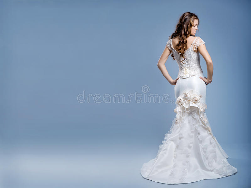 Wedding dress on fashion model royalty free stock photo