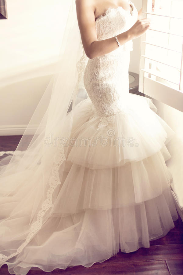 Wedding dress. On a mannequin stand stock image