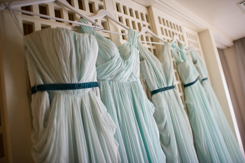 Wedding dress. Many bridesmaids wedding on windows royalty free stock photos