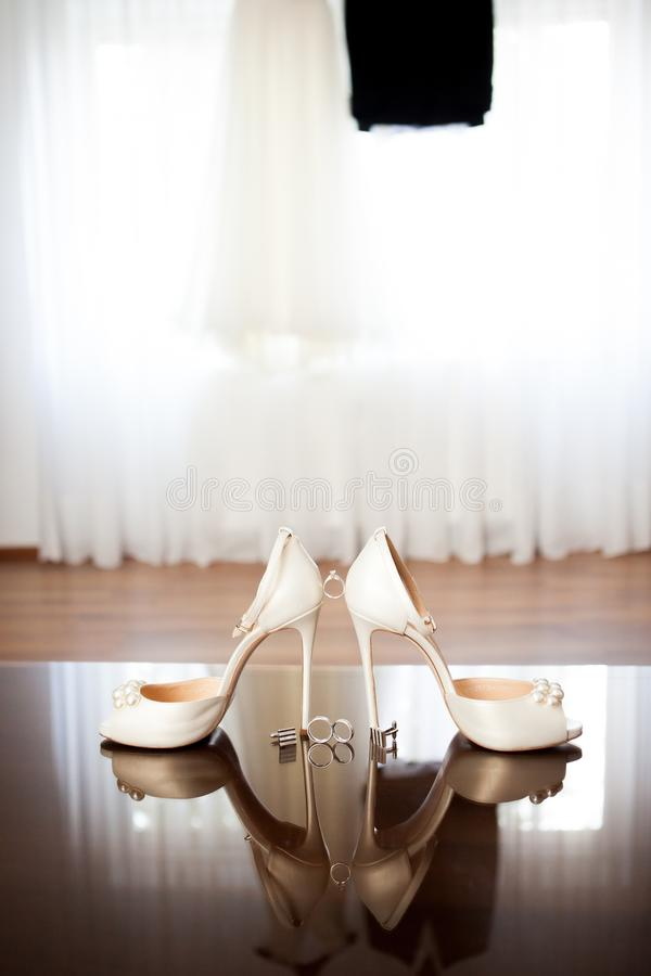 Wedding dress and shoes in a room royalty free stock photography