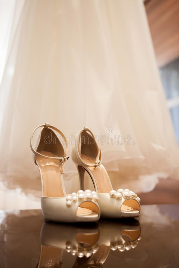 Wedding dress and shoes in a room royalty free stock images