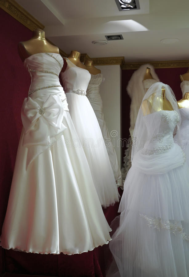 Wedding dresses. In the salon stock images