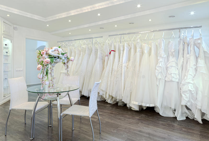 Wedding dresses. Collection of wedding dresses in the shop royalty free stock image