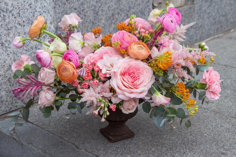 Wedding designer red pink orange bouquet of florist with different flowers, peony and roses royalty free stock images