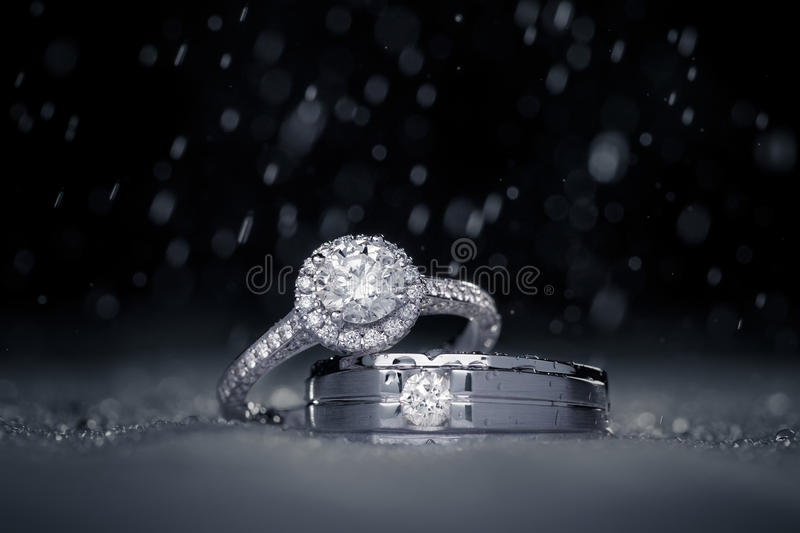 Wedding engagement diamond rings with water drops stock photo