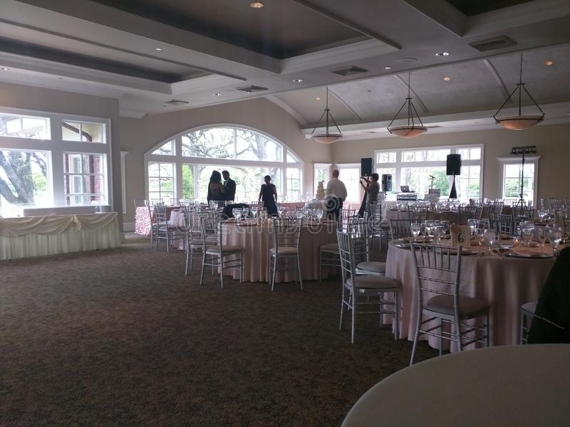 Wedding Event, serving table, guests, reception hall and servers royalty free stock photo