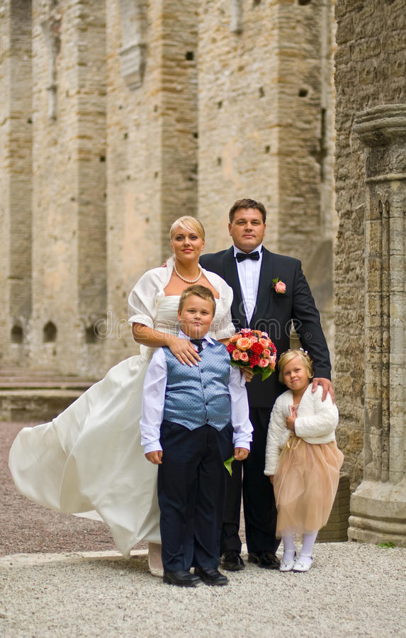 Wedding family. Plus size wedding couple with children royalty free stock images
