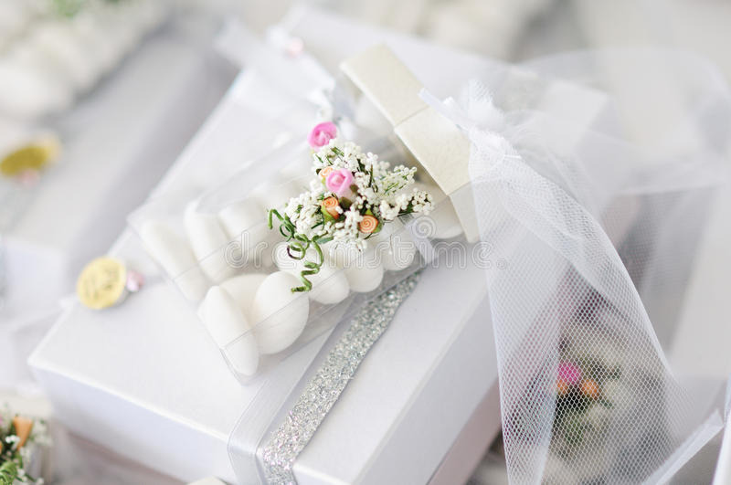 Wedding favors. Elegant Wedding Favors decorated with artificial flowers royalty free stock photo