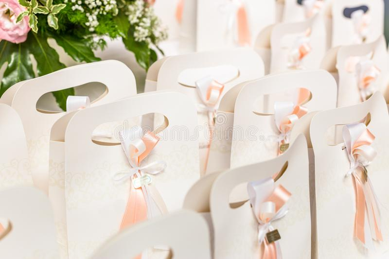 Wedding favors for wedding guests. Beautiful box wedding favors on the table for wedding guests royalty free stock image