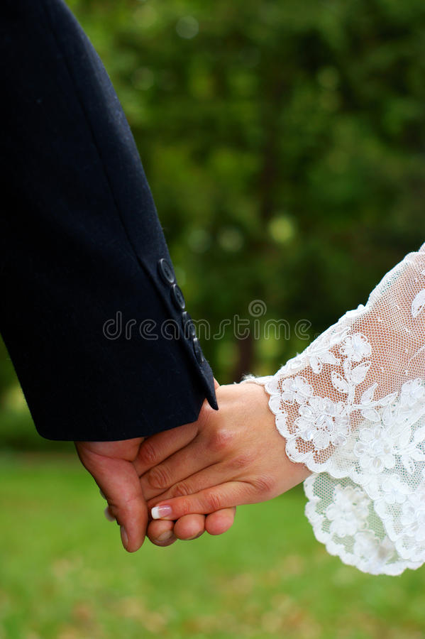 Wedding feelings. Couple holding hands. royalty free stock photography
