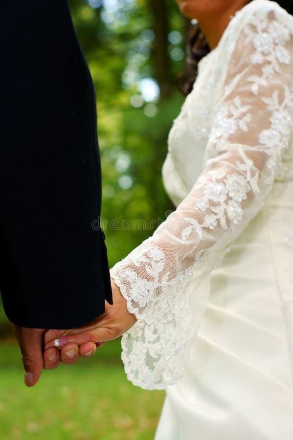 Wedding feelings. Couple holding hands stock image