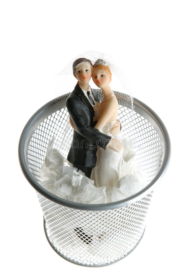 Wedding figurine on the paper trash royalty free stock photos
